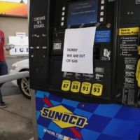 Stations in parts of the U.S.' Eastern Coast began running dry and prices at the pump rose due to the shutdown of the Colonial Pipeline by hackers, which sparked buying panic by motorists. | REUTERS