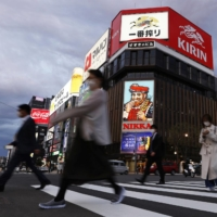 People walk in Sapporo's Susukino district on Thursday.   KYODO