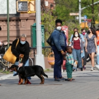 Pedestrians on the streets of Brooklyn, New York, on April 28   MICHELLE V. AGINS / THE NEW YORK TIMES
