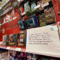 A sign telling customers that Pokemon trading cards will no longer be sold until further notice is displayed at a local Target store in Los Angeles on Friday.   AFP-JIJI