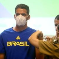 Brazilian athletes and staff traveling to Tokyo for the Summer Olympics receive the COVID-19 vaccine in Rio de Janeiro on Friday.   REUTERS