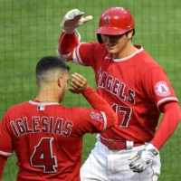 The Los Angeles Angels' Shohei Ohtani is greeted by shortstop Jose Iglesias after hitting a two-run home run in the third inning of a game against the Tampa Bay Rays at Angel Stadium in Anaheim, California, on May 6.     JAYNE KAMIN-ONCEA / USA TODAY / REUTERS