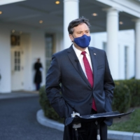 Ron Klain, U.S. President Joe Biden's chief of staff, is interviewed outside the White House on Jan. 26. Klain has been a constant in the president's meetings with his coronavirus team.  | DOUG MILLS/THE NEW YORK TIMES