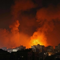 Smoke billows from a fire following Israeli airstrikes on multiple targets in Gaza City, in the Gaza Strip, on Sunday. | AFP-JIJI