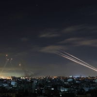Israel's Iron Dome missile defense system intercepts rockets fired by Hamas militants from Gaza City, in the Gaza Strip, toward Israel early Sunday. | AFP-JIJI