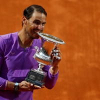 Rafael Nadal celebrates with the trophy after winning the Italian Open on Sunday in Rome. | REUTERS