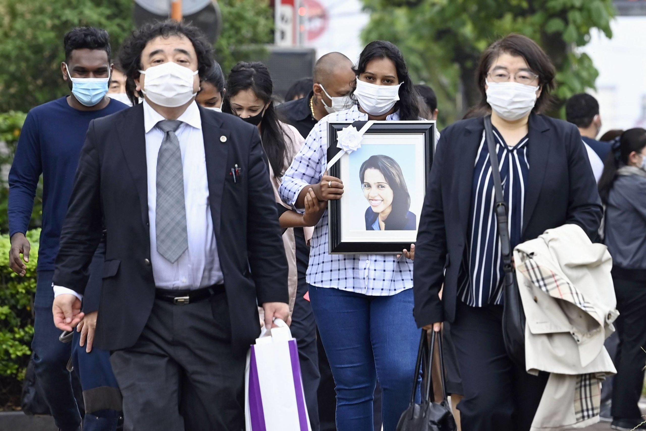 Family members of a Sri Lankan woman who died after being detained at the Nagoya Regional Immigration Services Bureau in Aichi Prefecture head to the facility on Monday to hear from officials about the circumstances of her death. | KYODO