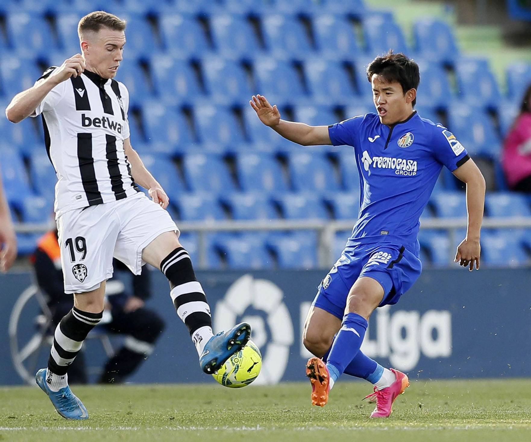 Takefusa Kubo (right) competes during Getafe's match against Levante on Sunday in Barcelona. | KYODO