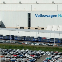 About 5,000 unfinished cars remain parked outside the Volkswagen Navarra factory in Pamplona, Spain, due to lack of semiconductor supplies. | AFP-JIJI
