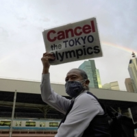 An anti-Olympics protester takes part in a rally in Tokyo on Monday.  | REUTERS