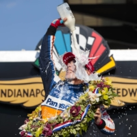 Takuma Sato celebrates with milk after winning the Indianapolis 500 at Indianapolis Motor Speedway on Aug. 23, 2020. | USA TODAY / VIA REUTERS