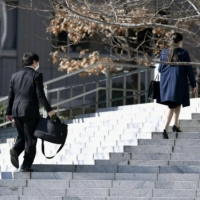 Students visit a company in Tokyo while job-hunting in March 2020. | KYODO