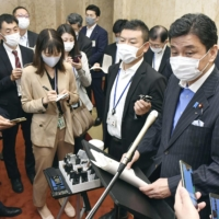 Defense Minister Nobuo Kishi speaks to reporters in Tokyo on Tuesday.   KYODO