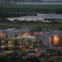 The South African Petroleum Refinery in Durban, South Africa, in November 2011. In Durban, homes are located near fuel infrastructure, a legacy of apartheid spatial planning that placed mostly Black communities in noxious industrial zones, environmental activists say.   REUTERS