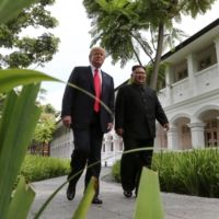 U.S. President Donald Trump and North Korea's leader Kim Jong Un before a working lunch during their summit in Singapore in June 2018. | REUTERS
