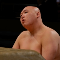 Alopecia may have prevented Taikomaru from growing enough hair for a traditional topknot, but it did not stop him from competing in professional sumo for eight years. | JOHN GUNNING