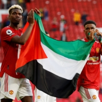 Manchester United manager defends players' Palestinian flag display
