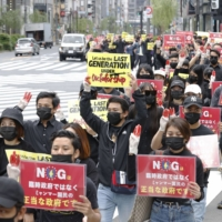 People march in Tokyo's Ginza district on May 2 to protest the military coup in Myanmar. | KYODO
