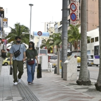 People walk along the main street of downtown Naha, Okinawa Prefecture, on May 4.   KYODO