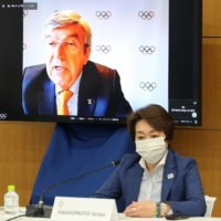 IOC president Thomas Bach (on screen) delivers his opening speech at a meeting of the IOC Coordination Commission for the 2020 Tokyo Olympics on Wednesday. | POOL / VIA REUTERS