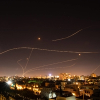 Israel's Iron Dome missile defense system fires to intercept rockets launched at Tel Aviv from the Gaza Strip on Sunday. | CORINNA KERN / THE NEW YORK TIMES