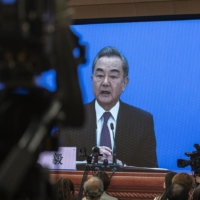 Chinese Foreign Minister Wang Yi answers a question during a virtual news conference in March.    | GETTY IMAGES / VIA BLOOMBERG