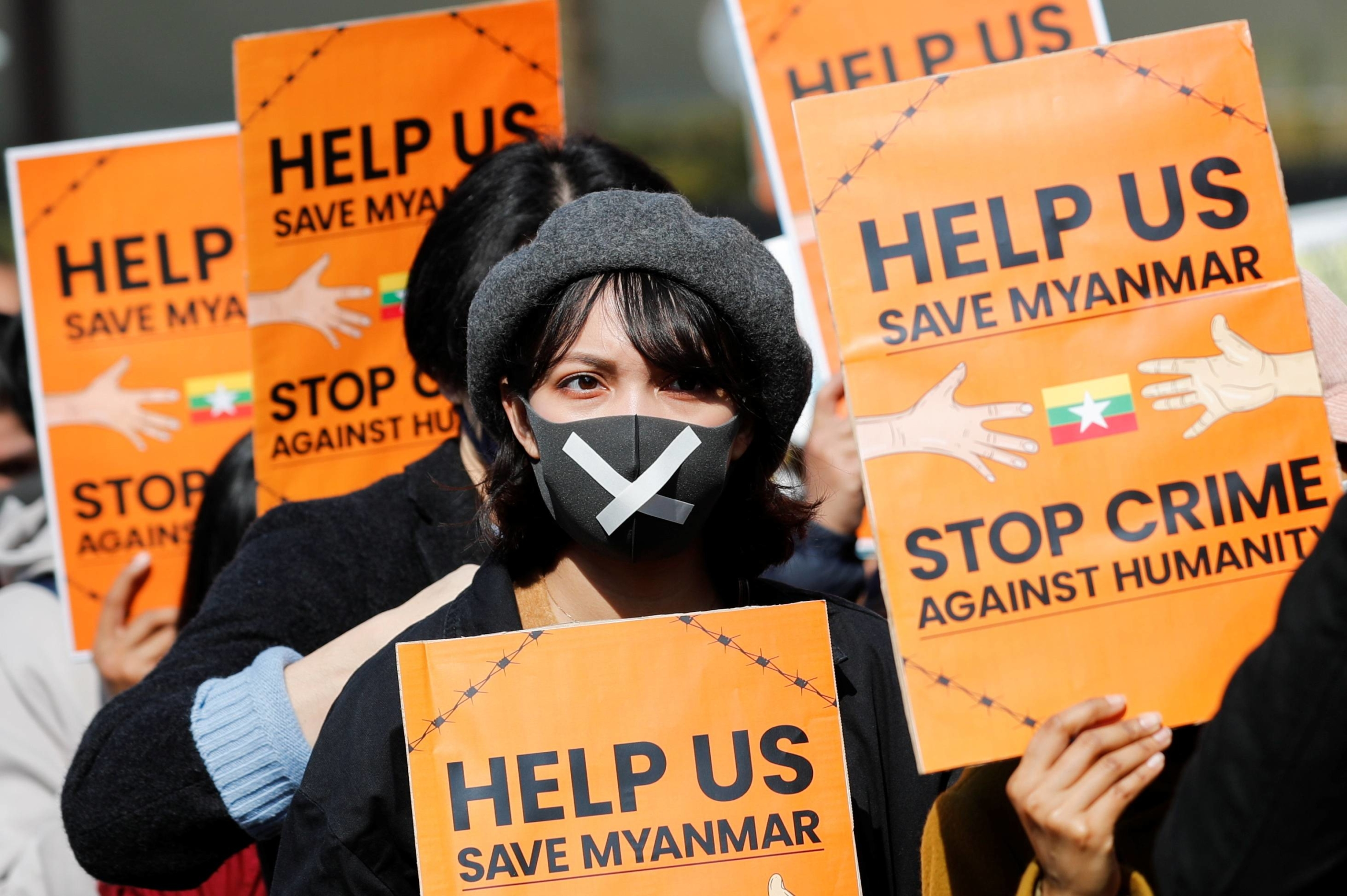 Demonstrators protest the military coup in Myanmar during a rally in central Tokyo in February.    REUTERS
