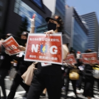 Myanmar residents in Japan stage an anti-coup rally in Tokyo on May 2. | KYODO