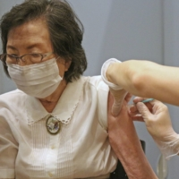Japan may issue COVID-19 vaccine recipients with certificates