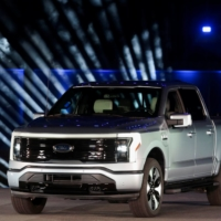 The all-electric Ford F-150 Lightning pickup truck is unveiled at the company's world headquarters in Dearborn, Michigan, on Wednesday.  | REUTERS