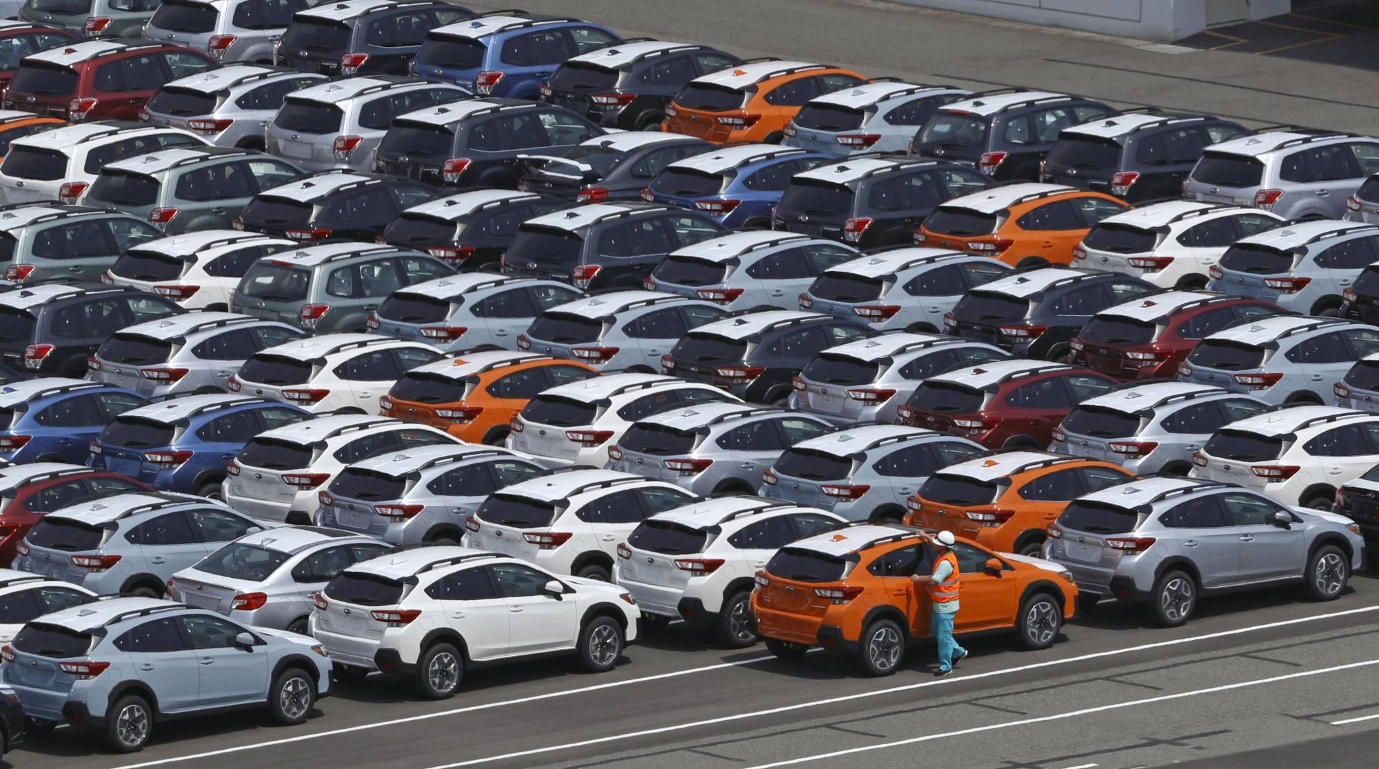 Cars for export await shipment at Kawasaki port. Exports rose 38% in April from a year earlier, compared with a 30.9% increase expected by economists and following a 16.1% rise in March, official data showed on Thursday. | KYODO