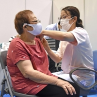 An older woman gets vaccinated in Yokohama on May 17. | KYODO