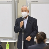 Akira Amari, who heads a ruling Liberal Democratic Party group on economic security, talks at a meeting in Tokyo on Thursday. | KYODO