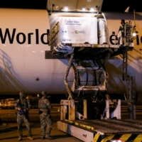 A refrigerated container containing Pfizer-BioNTech vaccines to protect against COVID-19 is unloaded at Viracopos International Airport in Campinas, Brazil, on April 29.   REUTERS