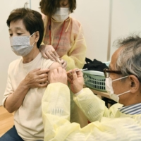 Nearly 38% of people in Japan want to be vaccinated against COVID-19 as soon as possible, according to a recent survey. | KYODO
