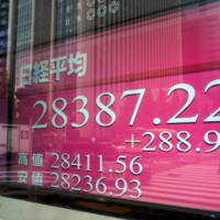 An electronic quotation board displays share prices in morning trading on the Tokyo Stock Exchange on Friday.  | AFP-JIJI