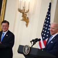 U.S. President Joe Biden and South Korean leader Moon Jae-in participate in a news conference in the State Dining Room of the White House in Washington on Friday. | AFP-JIJI
