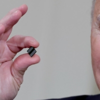U.S. President Joe Biden holds a semiconductor chip as he speaks prior to signing an executive order, aimed at addressing a global semiconductor chip shortage, in Washington in February.  | REUTERS