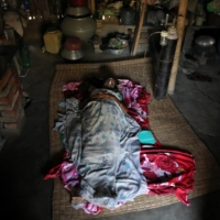 A woman with COVID-19 receives oxygen support inside her house in the village of Debipur in India's West Bengal state.    REUTERS