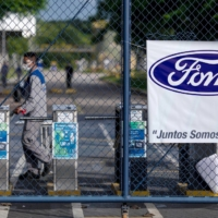 Workers protest outside a Ford Motor Co. plant in Taubate in January after the company announced it will close its three plants in Brazil.  | REUTERS