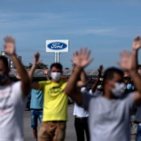 Workers protest outside a Ford plant in Taubate, Brazil, in January.  | REUTERS