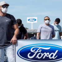 Workers protest outside a Ford plant in Taubate, Brazil, in January. A Ford spokesman in Brazil said the company was implementing 'a lean and asset-light business model in the region, with a truly customer-centric mindset'. | REUTERS