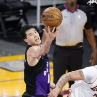 Yuta Watanabe (left) averaged 4.4 points and 3.2 rebounds per game for the Raptors this season. | AP / VIA KYODO