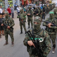 Members of Al-Qassam brigades, the armed wing of Palestinian Hamas group, march in Gaza City on Saturday.  | AFP-JIJI