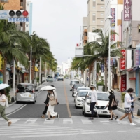 Central areas in Naha are quiet Sunday as Okinawa Prefecture is placed under a state of emergency. | KYODO