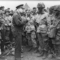 Allied forces Supreme Commander General Dwight D. Eisenhower speaks with U.S. Army paratroopers of Easy Company, 502nd Parachute Infantry Regiment (Strike) of the 101st Airborne Division, at Greenham Common Airfield in England in June 1944. Eisenhower, who would later become president, pushed back against generals urging nuclear strikes on mainland China in 1958 and decided to rely on conventional weapons at first.   U.S. NATIONAL ARCHIVES / VIA REUTERS