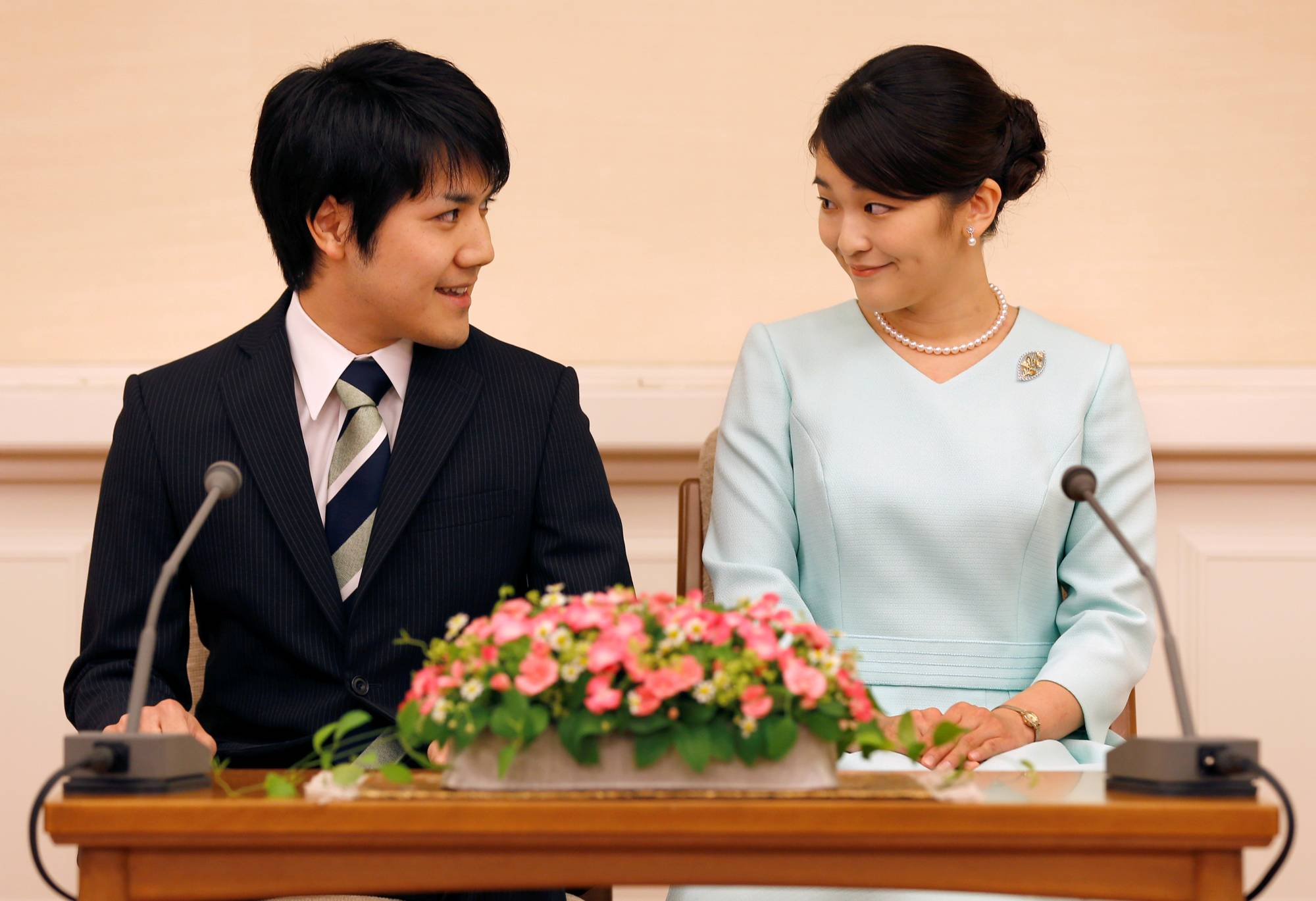 Princess Mako, the elder daughter of Crown Prince Akishino and Princess Kiko, and Kei Komuro, smile during a news conference to announce their engagement in Tokyo, in September 2017. | POOL / VIA REUTERS