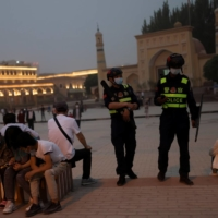 Police officers patrol the square in front of Id Kah mosque in Kashgar, in China's Xinjiang region, on May 3. | REUTERS