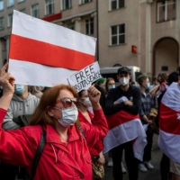Belarusians living in Poland and Poles supporting them take part in a demonstration in front of the European Commission office in Warsaw on Monday, demanding freedom for Belarus opposition activist Roman Protasevich. | AFP-JIJI