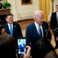 U.S. President Joe Biden and his South Korean counterpart, Moon Jae-in, depart after a news conference at the White House on May 21. | BLOOMBERG